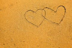 Texture of sand: the inscription two hearts Stock Photography