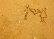 Texture of sand: a pair holding a big heart Stock Photos