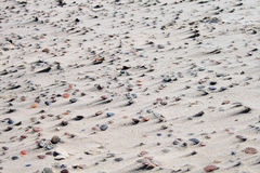 Texture of sand and stones on the beach Stock Photos