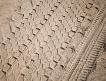 Texture of sand with truck tires Stock Images
