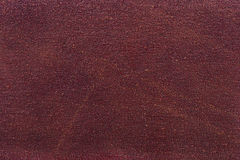 Texture of sandpaper. Texture of rough red sandpaper Royalty Free Stock Image