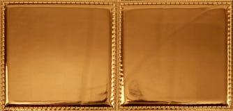 Texture sans joint de configuration de tissu en plastique d'or Photographie stock