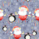 Texture of Santa Clauses and penguins Royalty Free Stock Photo