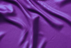 Texture satin. silk background. shiny wavy pattern canvas. color fabric, cloth purple. Royalty Free Stock Images