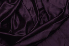 Texture satin. silk background. shiny wavy pattern canvas. color fabric, cloth purple Royalty Free Stock Photography