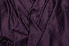 Texture satin. silk background. shiny wavy pattern canvas. color fabric, cloth purple. Texture satin. silk background. shiny wavy pattern canvas. cloth purple Stock Images