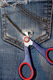 Texture scissors which cut a hole in your pocket Royalty Free Stock Photo