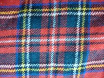 The texture of the Scottish fabric in the cell. Red, blue, yellow and white color royalty free stock image