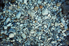 The texture of sea pebbles. stones to the , close. The texture of sea pebbles. Light stones to the sea, close Stock Photo