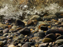 Texture of sea surface and pebbles. Texture of transparent sea water and pebbles Stock Photo