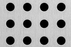 Texture Series - Aluminum with Holes. Sheet aluminum with twelve similar sized holes drilled out stock photos