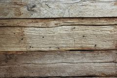 A texture of several nailed boards. Texture of old vintage boards. Classic vintage background of an aged tree Royalty Free Stock Image