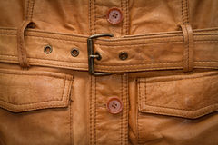 Texture a shabby brown leather jacket. Royalty Free Stock Image