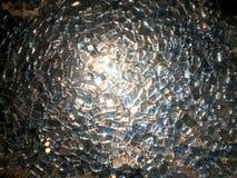 The texture of shiny glass, illuminated precious diamond stones, fragments of rhinestones square pure light transparent silvery, d. Ecoration, decoration royalty free stock photography