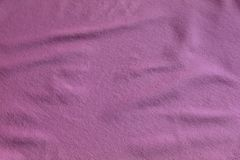 The texture of silk fabric. The material is pink royalty free stock image