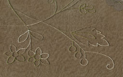 Texture of silk fabric with an oversized visitim thread pattern of floral ornament. The Victorian style of the Northern art Nouvea Stock Photos