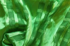 Texture of silk green fabric with pleats Stock Photo