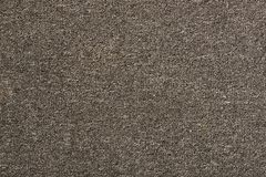 Texture of a simple carpet. Gray background stock images