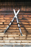 Texture And Skis. Wooden texture with a pair of skis in the middle Stock Photo