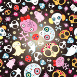Texture of skulls and ghosts. Bright seamless pattern of funny skulls and ghosts on a dark background Royalty Free Stock Photo