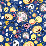 Texture of the skulls and pumpkins. Seamless pattern of yellow pumpkins and skulls on a blue background Royalty Free Stock Images