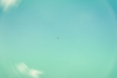 Texture of sky, beautiful turquoise or azure color, white fluffy clouds. High in the sky flies copter, drone. Quadrocopter. For modern background, wallpaper or royalty free stock photos