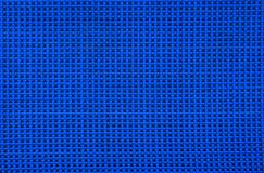 The texture is in a small bright blue with a black cell royalty free stock photography