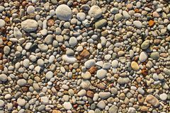 Texture of small sea pebbles and stones stock photos