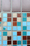 Texture of small square tiles. Beige, blue, turquoise and brown Royalty Free Stock Photography