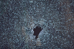 Texture of smashed glass window. Background Texture of smashed glass Stock Image