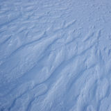 The texture of the snow. Snow texture formed by a strong wind Stock Photos