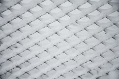 Texture of snow on the fencing net. Metal wire mesh covered with snow in winter. Beautiful winter. White snow on wire metal mesh fence. Blurred snowy nature on royalty free stock photos