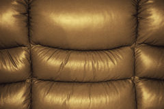 Texture of Sofa Leather. Golden-Brown Texture of Sofa Leather Background Stock Photo