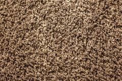 The texture is soft shaggy carpet brown stock photos