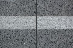 The texture of solid granite tiles. Hard and slippery gray granite surface. Close up stock illustration