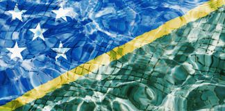 Texture of Solomon islands flag. In the pool, water. Circles on the water Stock Photography