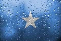 Texture of Somalia flag. On the glass with drops of rain at dawn royalty free stock photo
