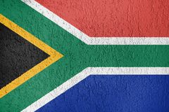 The texture of South Africa flag on the wall stock illustration