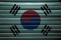 Texture of South Korea flag. Texture of South Korea flag on blue metal strips royalty free stock photography
