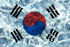 Texture of South Korea flag. Texture of South Korea flag in the pool, water. Splashes stock photography