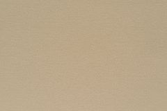 Texture speckled fabric or paper material of pale beige color Royalty Free Stock Photos