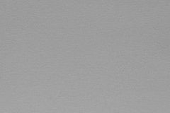 Texture speckled fabric or paper material of pale gray color Royalty Free Stock Images