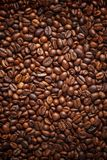 Texture spilling coffee beans. Top view. Copy space stock image