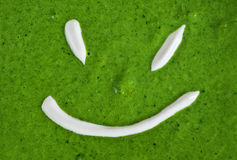 Texture of spinach cream soup smiling Royalty Free Stock Photo