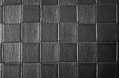 The texture of the squares black woven leather. Background. The horizontal frame Stock Images