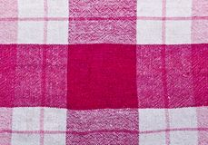 Texture of squares. A red texture of squares from a tablecloth stock image