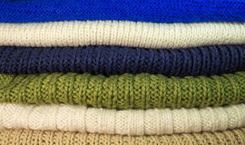 Texture. Stack of knittings. Colorful handmade knitwear Royalty Free Stock Photos