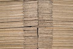 Texture of stacked on each other sheets of cardboard representing the unformed boxes for product packaging. stock photos