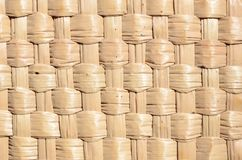 The texture of the standard weaving of straw. The texture of the standard binding of straw. Straw weaving for hats, baskets and household goods. Natural material stock photos