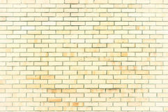 Texture stone background of light yellow brick wall, texture wall surface with light bricks. Stone texture background of brick wall, texture surface with stone Stock Photos